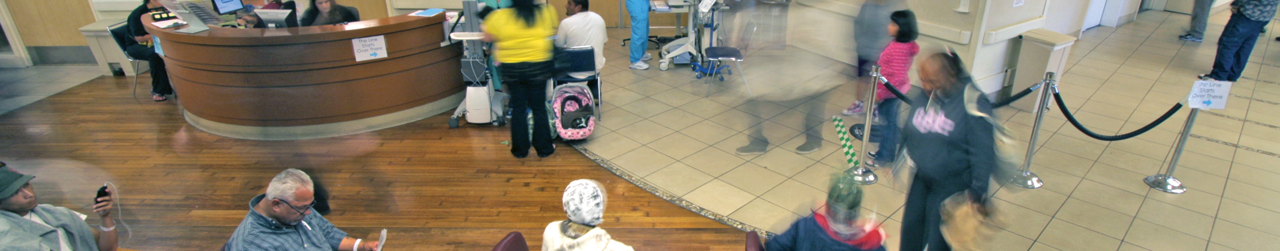 Hospital lobby with people moving about