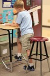 Elementary school student working at standing desks