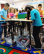 Elementary school students working at standing desks
