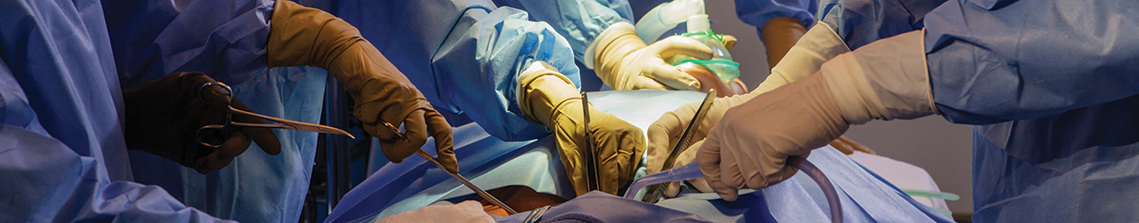 Doctors performing open surgery