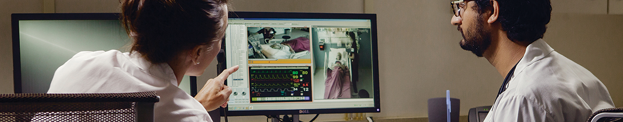 Doctors monitoring patients on a screen